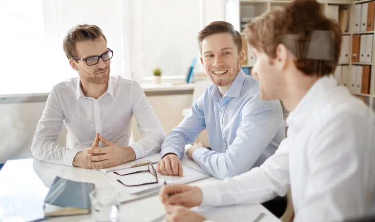 Group of businessmen discussing plans in office